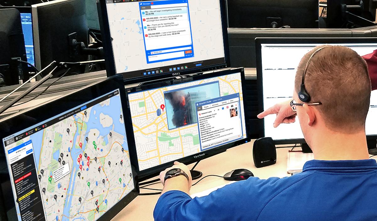 emergency dispatch coordinator sitting at computer terminal
