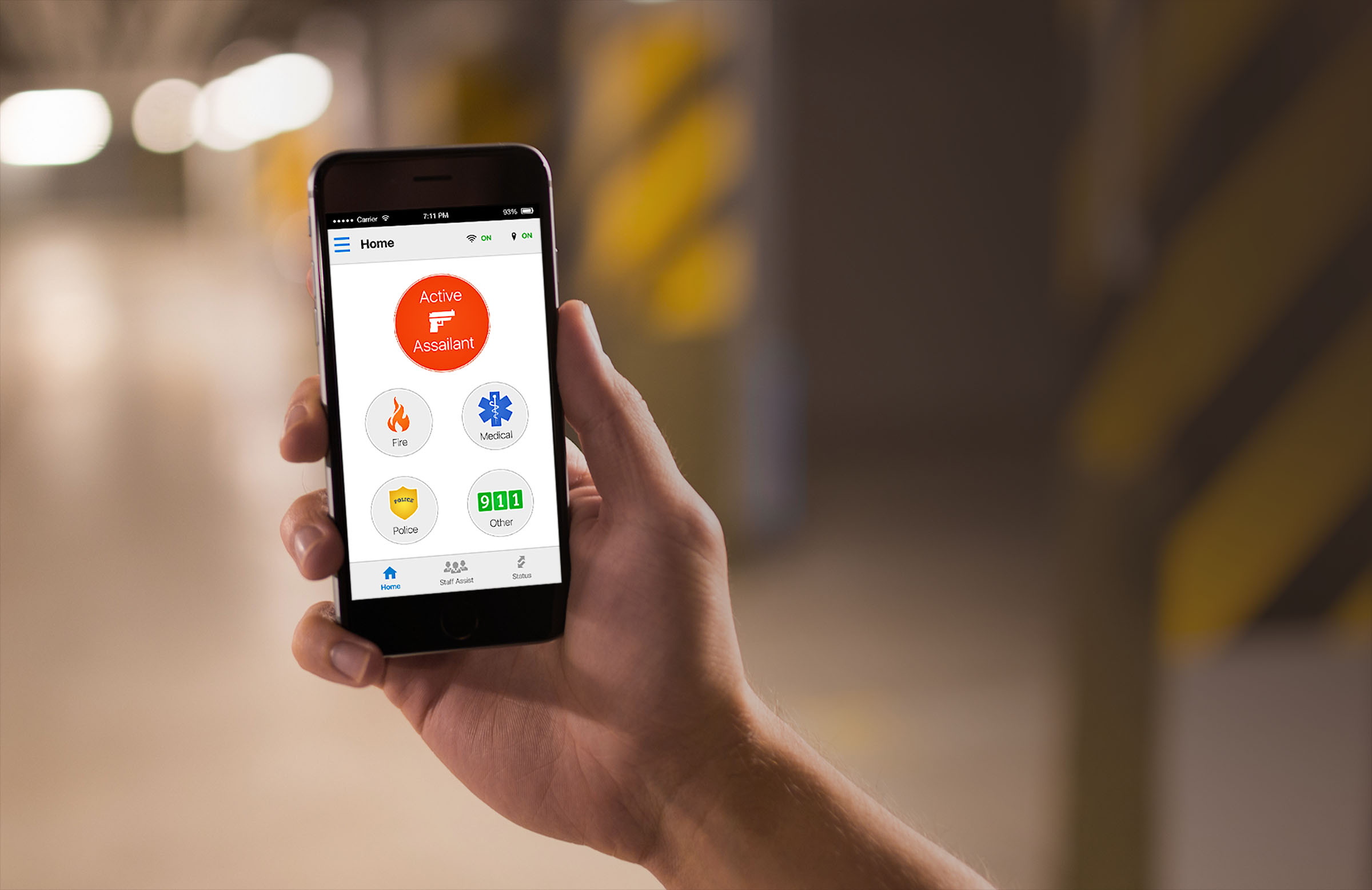 hand holding phone with panic button app on screen