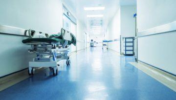 hospital corridor with bed in hallway