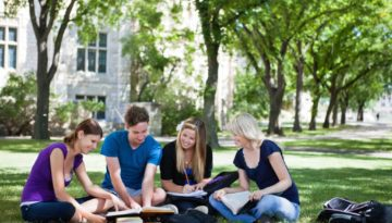 college students sitting in circle studying outside