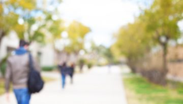 blurred college students walking