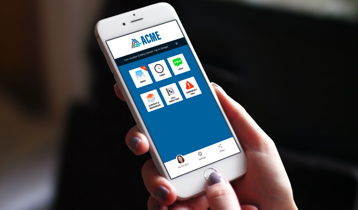 hand holding cell phone with rave guardian app on screen