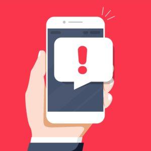 cartoon hand holding phone with alert