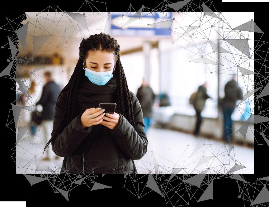 woman on phone wearing mask vingette